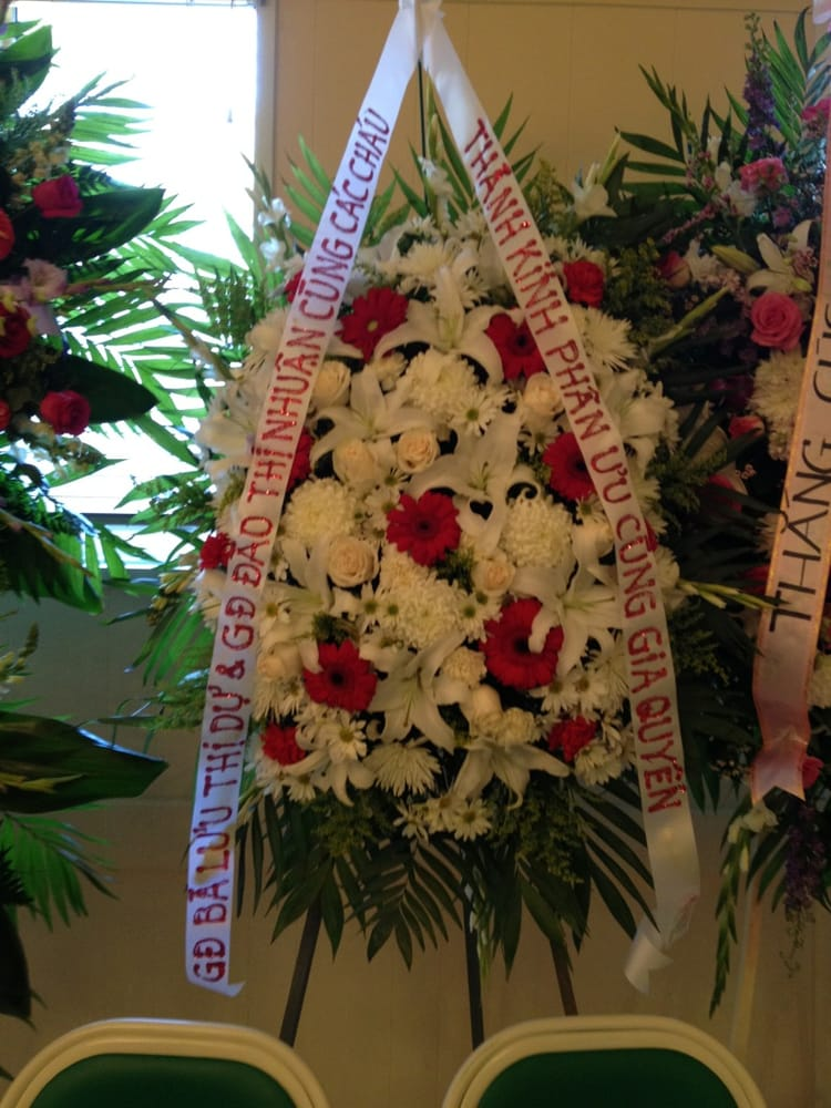funeral flowers spray notice the pretty writing compared to the