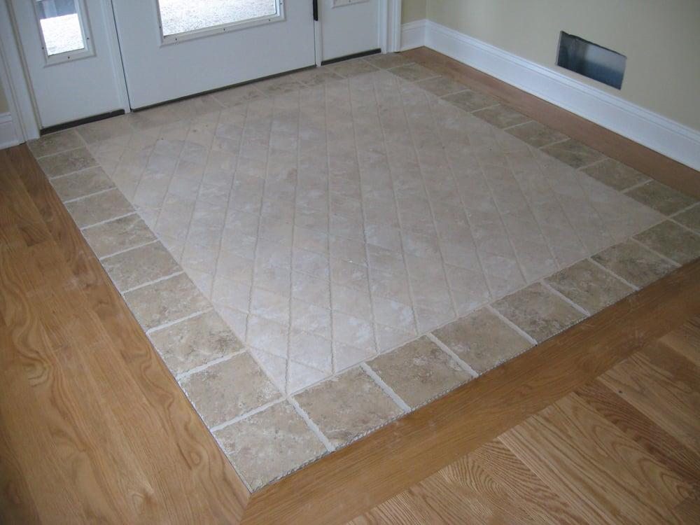 Tile Floor Inlays : Custom tile inlay in entrance yelp
