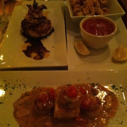Broadway Bistro - Nyack, NY, United States. Sea Scallops with Sherry Sauce on Polenta, Shrimp on Pasta Pancake, Calamari
