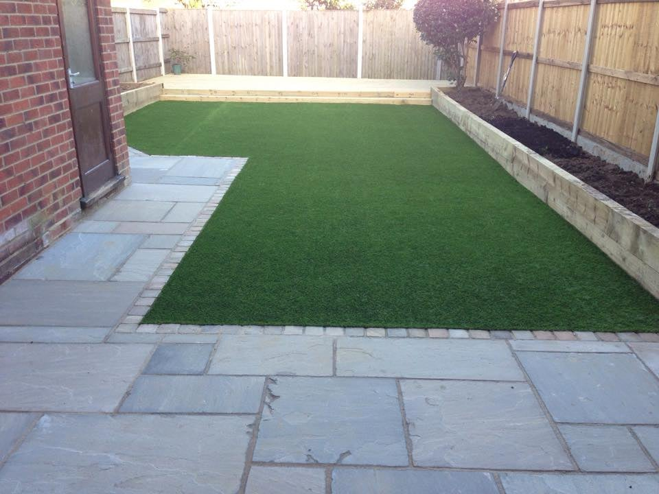 Indian sandstone patio sleeper raised flower beds for Garden decking with artificial grass