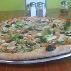 Photo of Greenhouse Kitchen Italian Restaurant - Brighton, MA, United  States. Our garden
