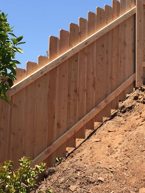 Long Cedar Wood Fence Built Up A Steep Hill In Rancho