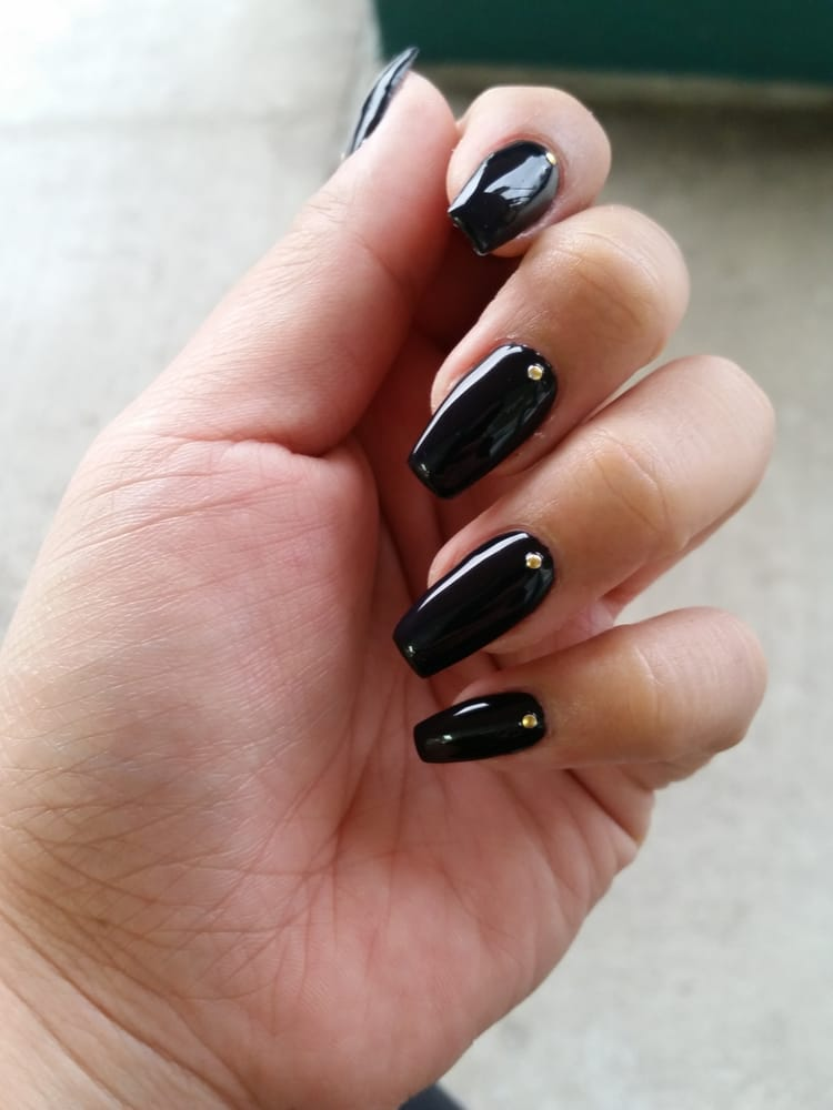 Acrylic coffin shaped black gel nails with gold studs done by Leanne ...