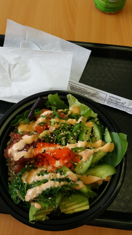 Poke bowl with salmon and spicy ahi tuna with salad ...