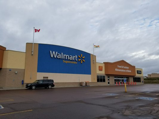 Walmart Canada - Walmart Canada first-of-its-kind sale floor LED Walmart Canada customers in frozen food section Cars Driving by Entrance of Walmart Supercenter Canada.