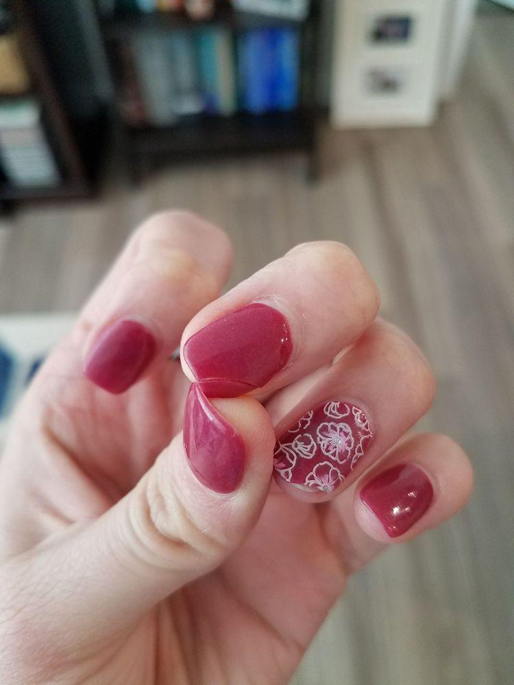 Middle finger cracked, ring finger with the cracked corner missing ...