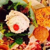 Photo of Olde English Tea Room - Wake Forest, NC, United States. stuffed tomato with chicken salad, cinnamon muffin and carrot salad. My friend said it was delish.