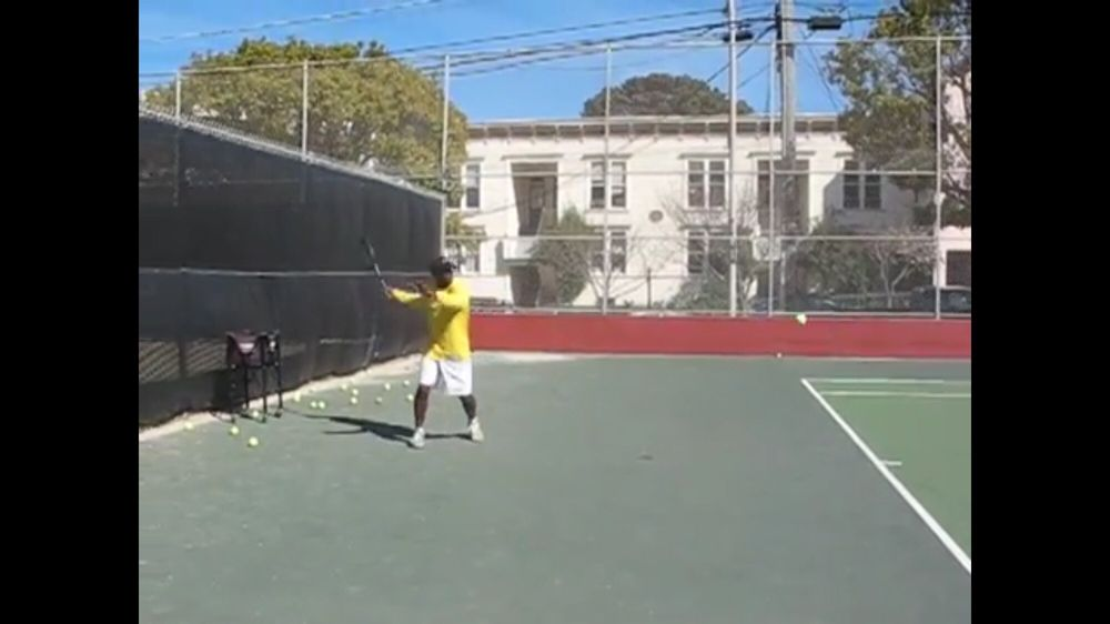 Photo of Tennis Lessons By Mcclain - San Francisco, CA, United States. Notice how the racket is back early, and I'm in perfect position to hit the ball, left hand is out for balance