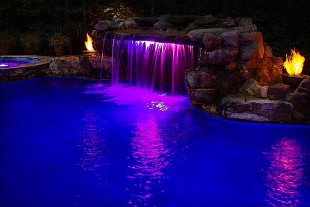 Beautiful Pool And Natural Boulder Grotto Cave With Fire