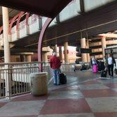 'Photo of McCarran International Airport - Las Vegas, NV, United States. Bridge to pickup location' from the web at 'https://s3-media1.fl.yelpcdn.com/bphoto/r_HNp8lBTQUHMGUmMGNXvA/168s.jpg'