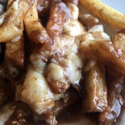 Photo of Crooked Goose Bistro - Victoria, BC, Canada. Poutine. Made with house gravy (not GF) and just like the wings, sprinkled in magic.