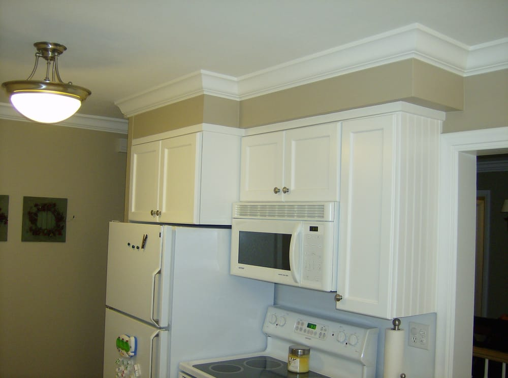 adding crown molding to kitchen cabinets we added crown molding to this kitchen custom trim on the 10461