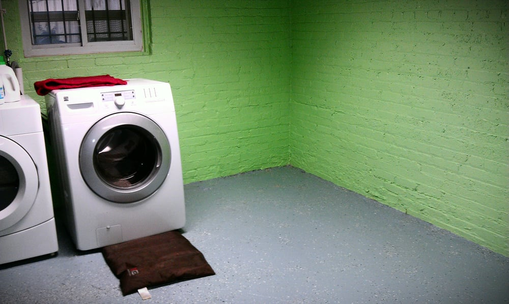 basement floor cleaned and painted with epoxy and walls painted by