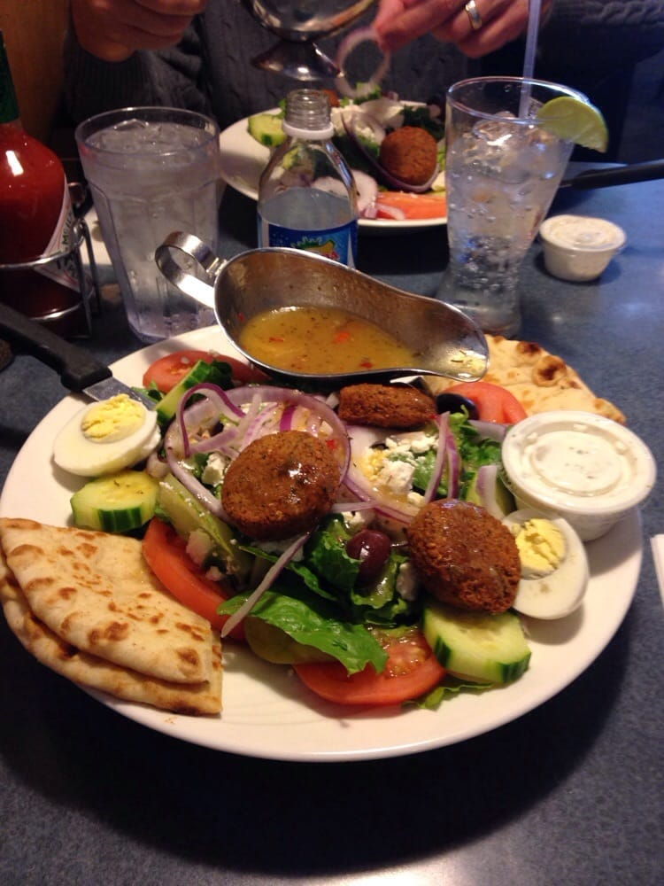 Photo of Chef Zorba's Cuisine - Denver, CO, United States. The Athenian with falafel. Includes egg, dolmades, feta, olives and more, plus warm fresh pita slices. Yummy!