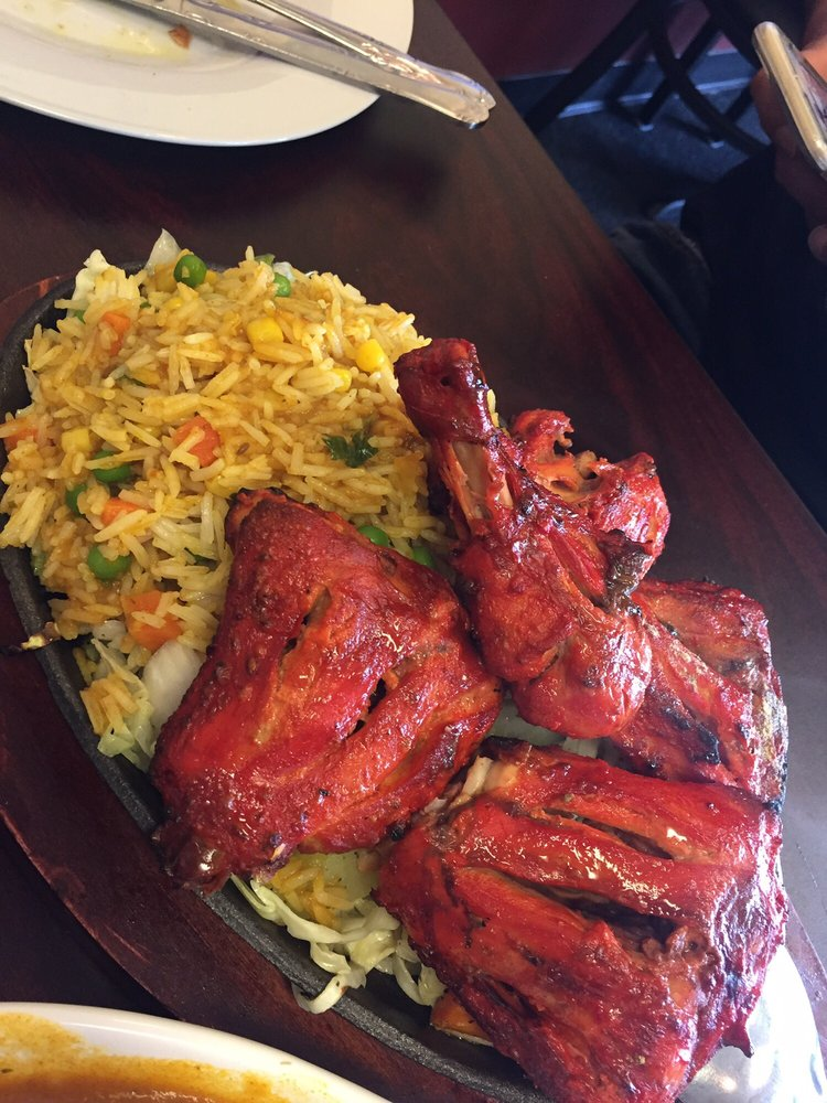 Tandoori chicken with fried rice over sizzling plate yelp for Aman indian cuisine