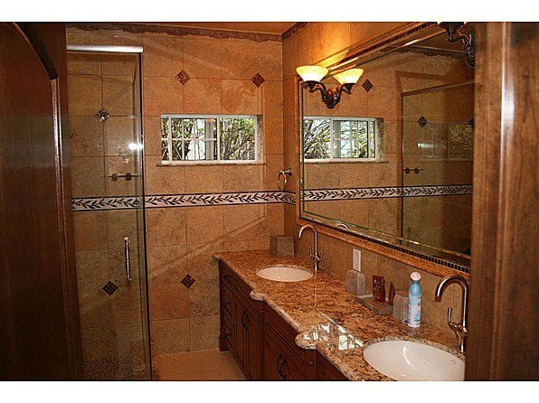 Bathroom With Two Sink Light Fixtures, Shower Light