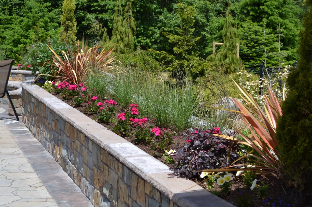 Retaining wall with planter box yelp for Retaining wall plants landscaping