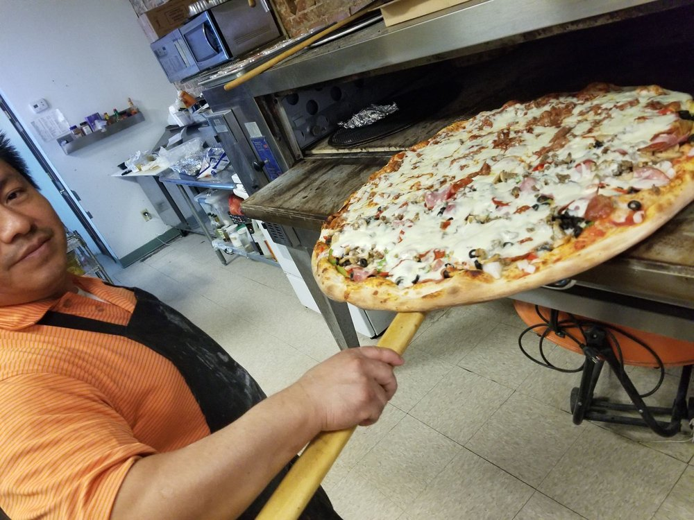 Milano's Pizza: 128 W Liberty Ave, Covington, TN