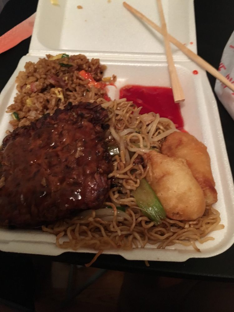 Lunch plate with all four choice: pork fried rice, chow mein, sweet and sour chicken with sauce on side and egg foo young total: $5