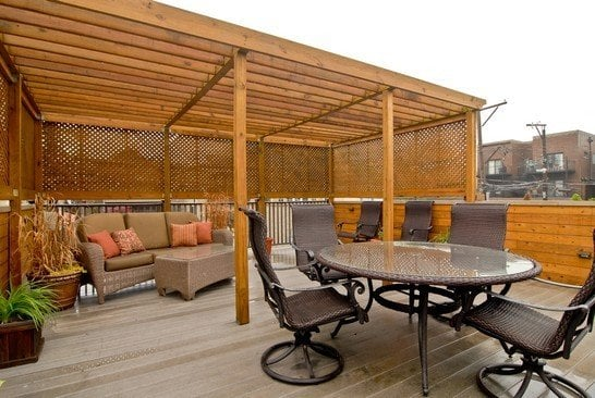 Garage roof top deck with a pergula is a great way to for Garage with deck on top