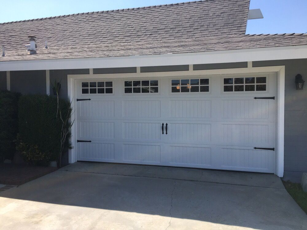 White, long panel, Carriage model, steel back garage door with Magna