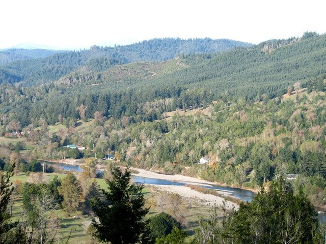 An aerial view of the chetco river near the atrivers edge for Chetco river resort cabins brookings oregon