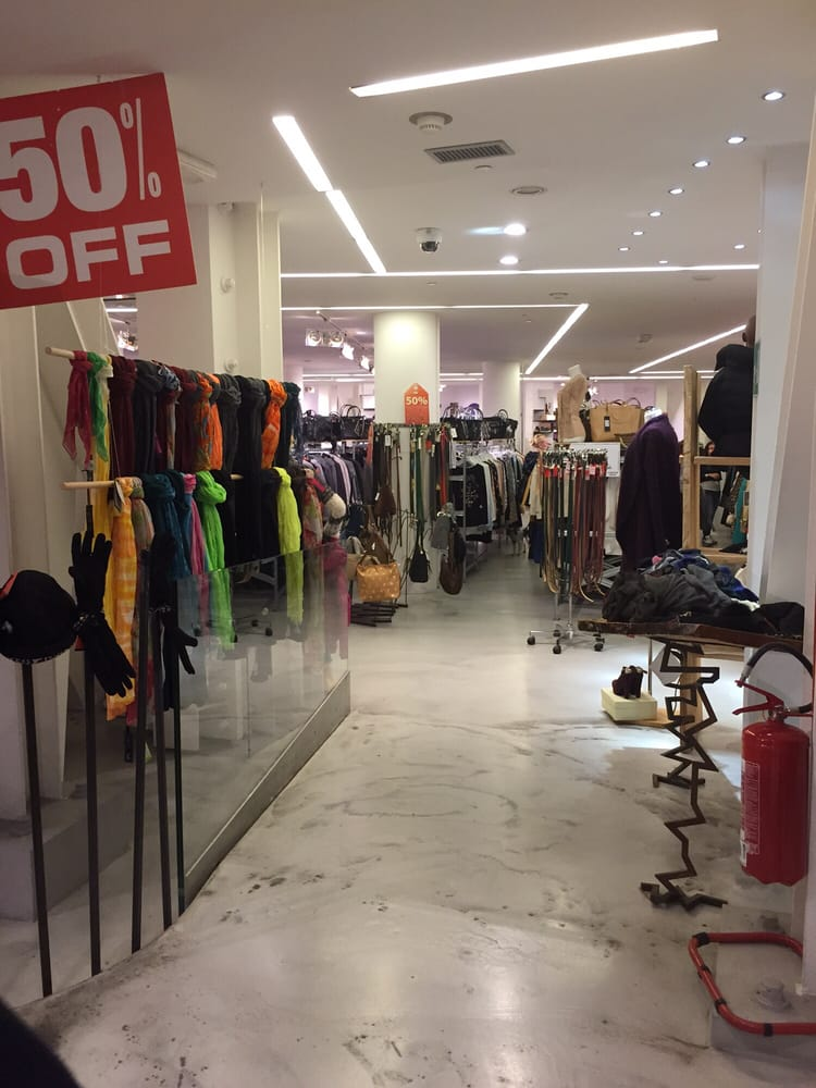 Clothing racks yelp for Milano fashion outlet