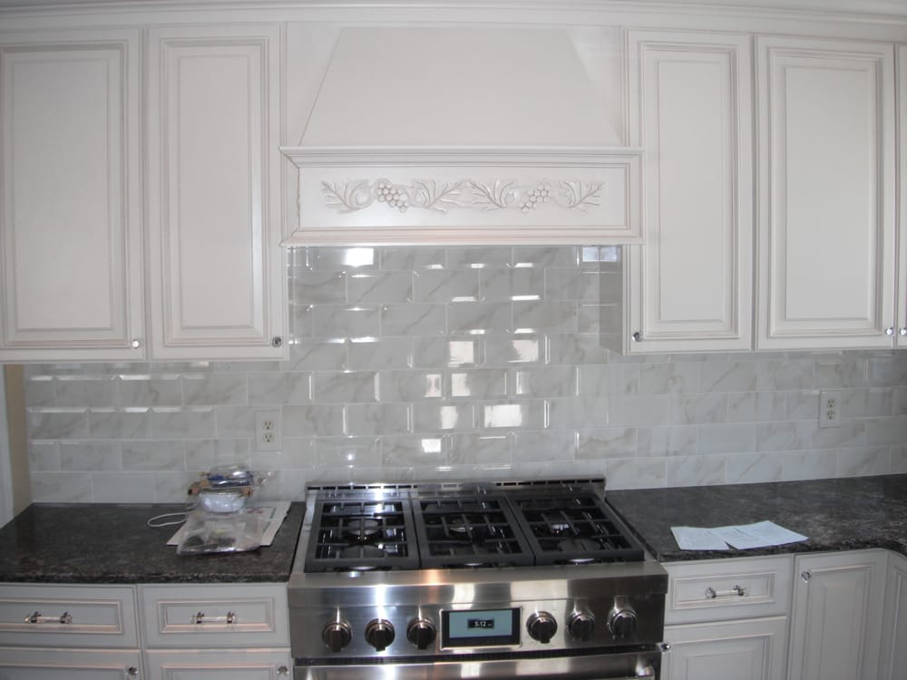 wellington ivory cabinets carrara marble subway