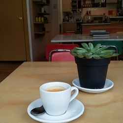 Photo Of Pinecone Coffee Hamilton On Canada Espresso And A Plant On