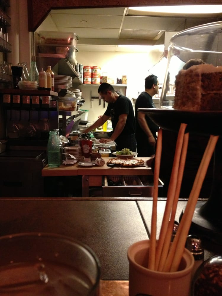 Sit at the bar and watch the chefs in action then applaud for Food bar petaluma