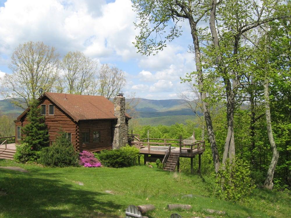 Mountaintop magic log cabin case appartamenti per for Stili di log cabin