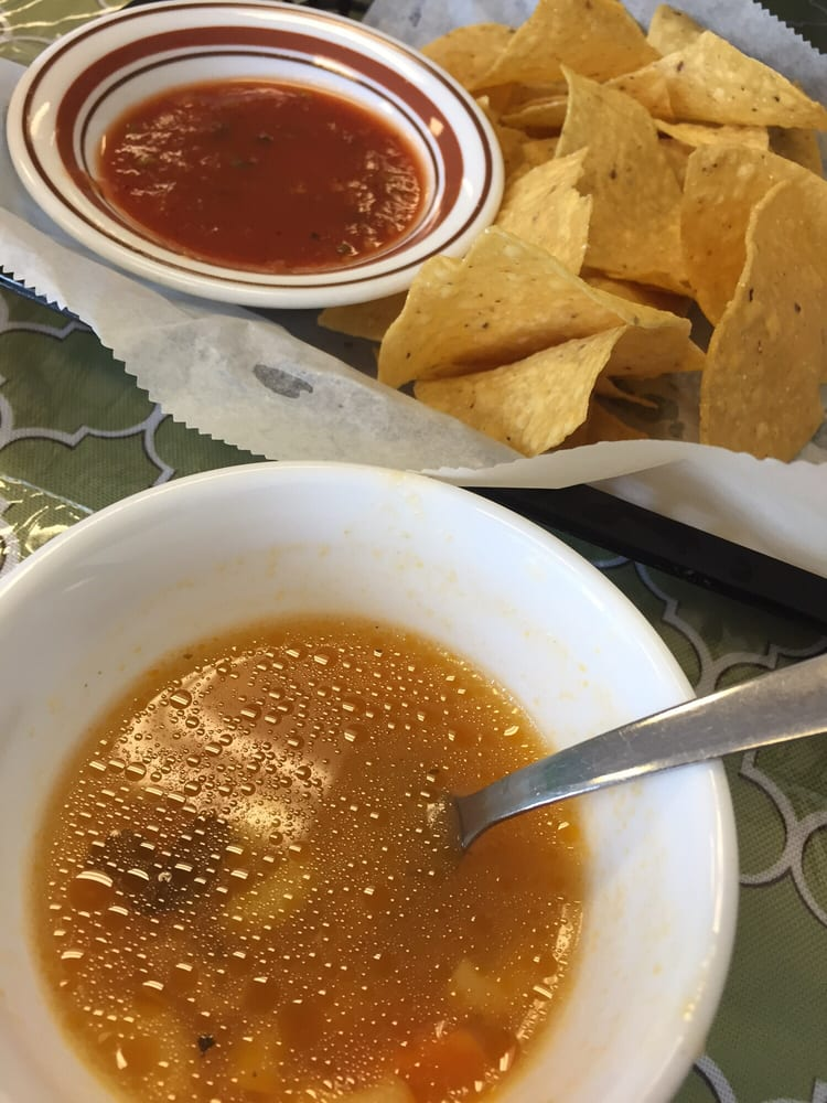 mexican sopa de coditos chicken soup came with chips and salsa on