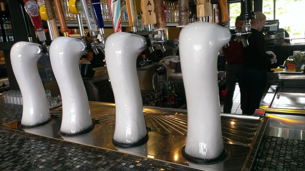 beer taps are covered in ice. makes the beer even more chilled. - Yelp