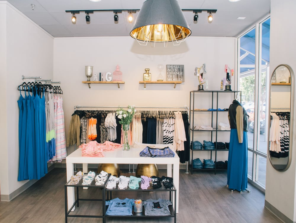 The warm and comfy interior of hgsb yelp for Interior boutique designs