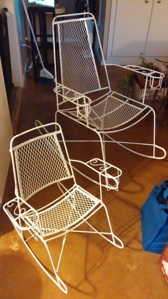 Matching metal rocking chairs with built in cup holders