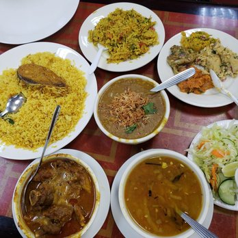 Photo of Haat Bazaar - Jackson Heights, NY, United States. Great food! Pictured here clockwise: Potato bhajee (fried potato), various bharta (mashed spicy veggies), salad, daal, haleem, goat curry