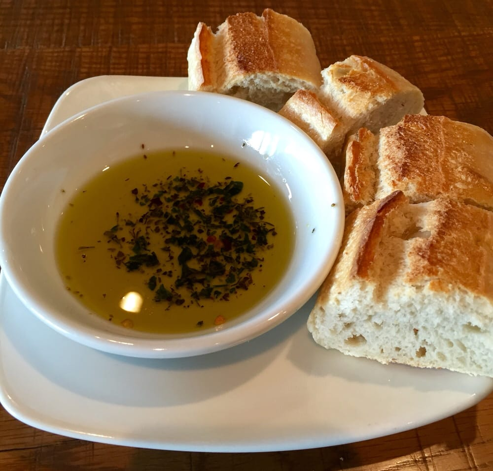 plimentary bread and oil with spices for dipping Yelp