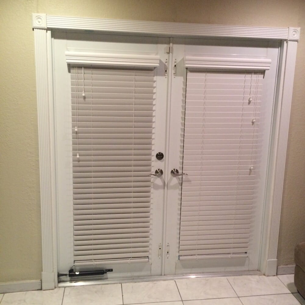 White Faux Wood Horizontal Blinds Mounted On French Doors