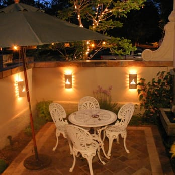 Small Italian Courtyard With Slate Flooring And Outdoor