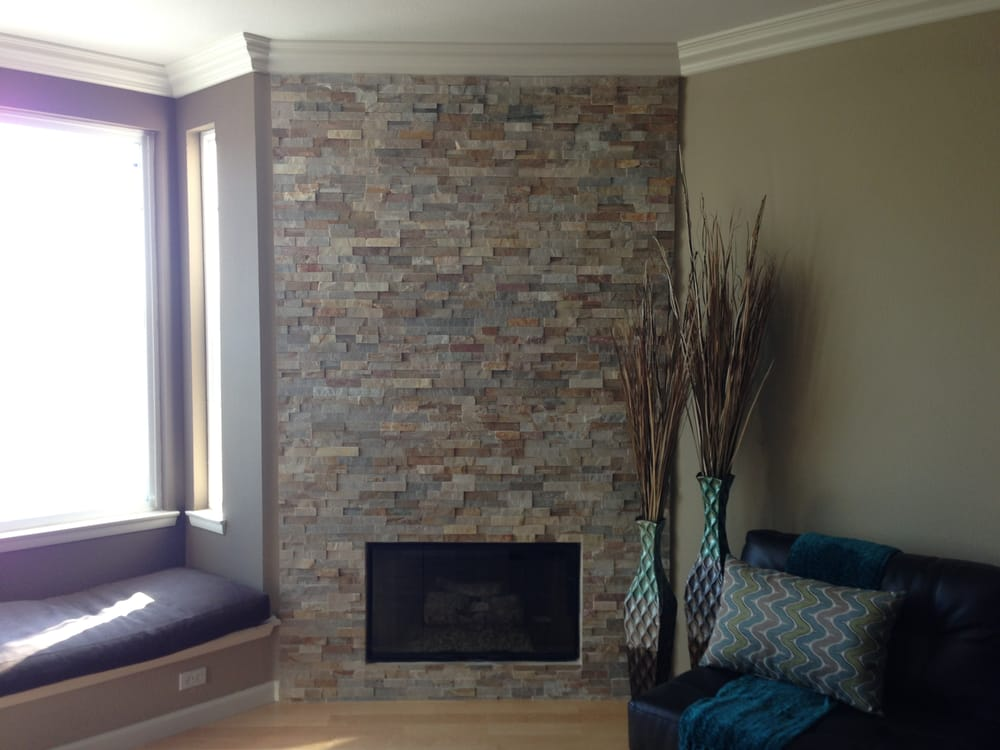 "Photo of Flamingo Tile - ""Complete makeover with this stunning new quartz natural stone tile fireplace.  AJ and Chris did an amazing job!"" - San Diego"
