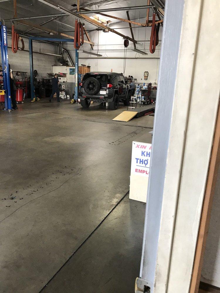 Thanh auto repair 27 foto 39 s 219 reviews garages for Mechanic shop flooring