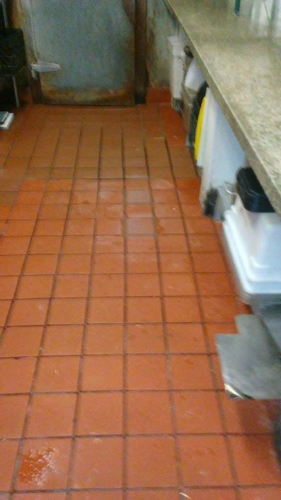 Commercial Kitchen Floor Repair Prior To Fix Tiles Had Come Loose
