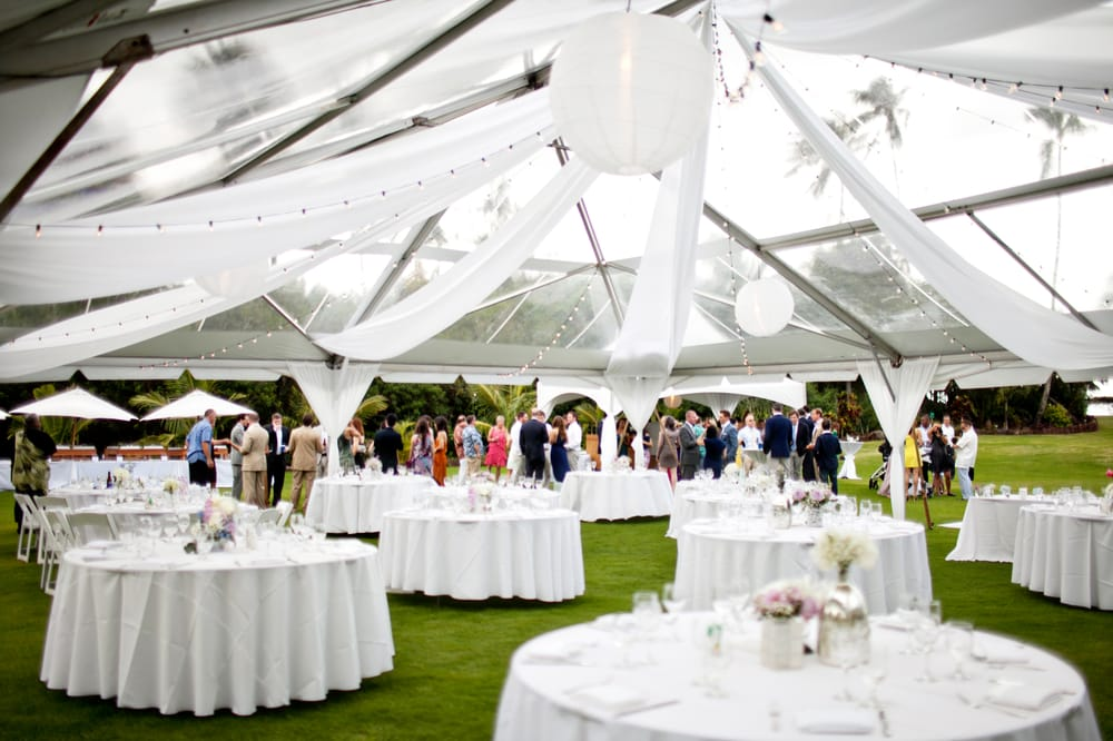 White Draping Under A Clear Top Tent With Cafe Lights And