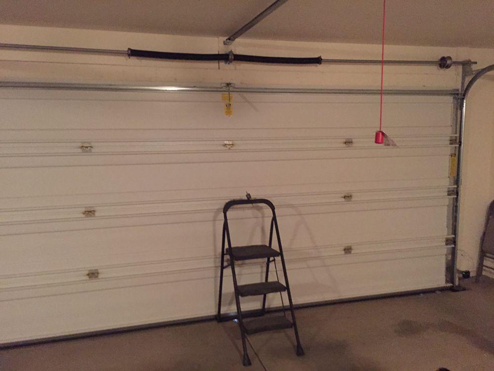 Monkey garage door company 30 foto servizi per porte for 2 piedi quadrati per garage