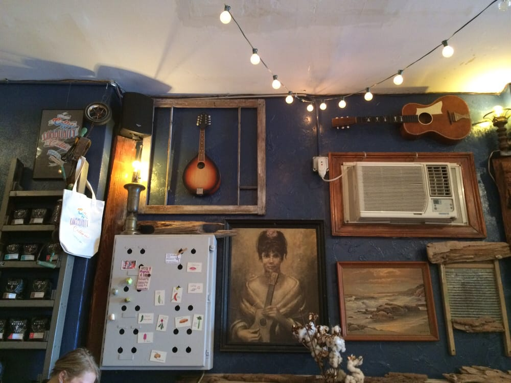 Photo of Roots Café - Brooklyn, NY, United States. Love the random art!