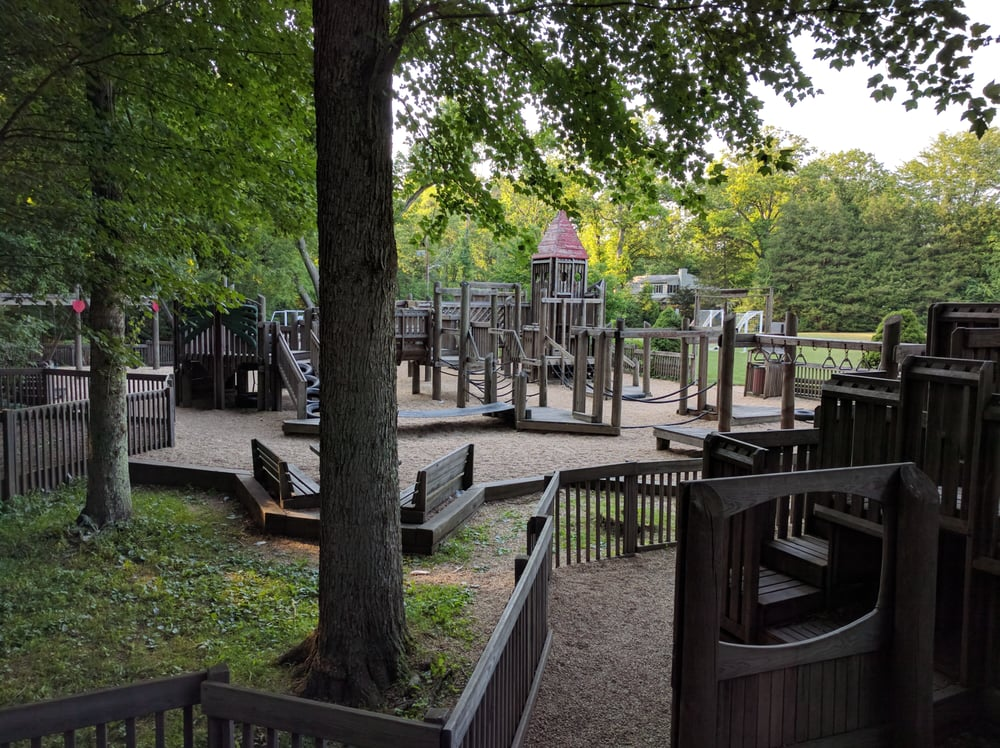 "Photo of Haworth Memorial Park ""Castle Park"" Playground - Haworth, NJ, United States. Shaded playground with all wood fixtures."