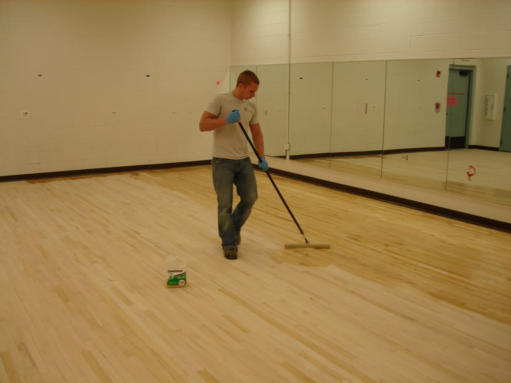 Here we are applying finish on the lake zurich park for Hardwood floors lake zurich
