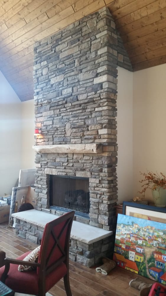 "Photo of Brighton Stone & Fireplace - ""Fireplace done in Echo Ridge Country Ledgestone by Boral Cultured Stone with wood mantel and custom masonry fireplace doors."" - Brighton"