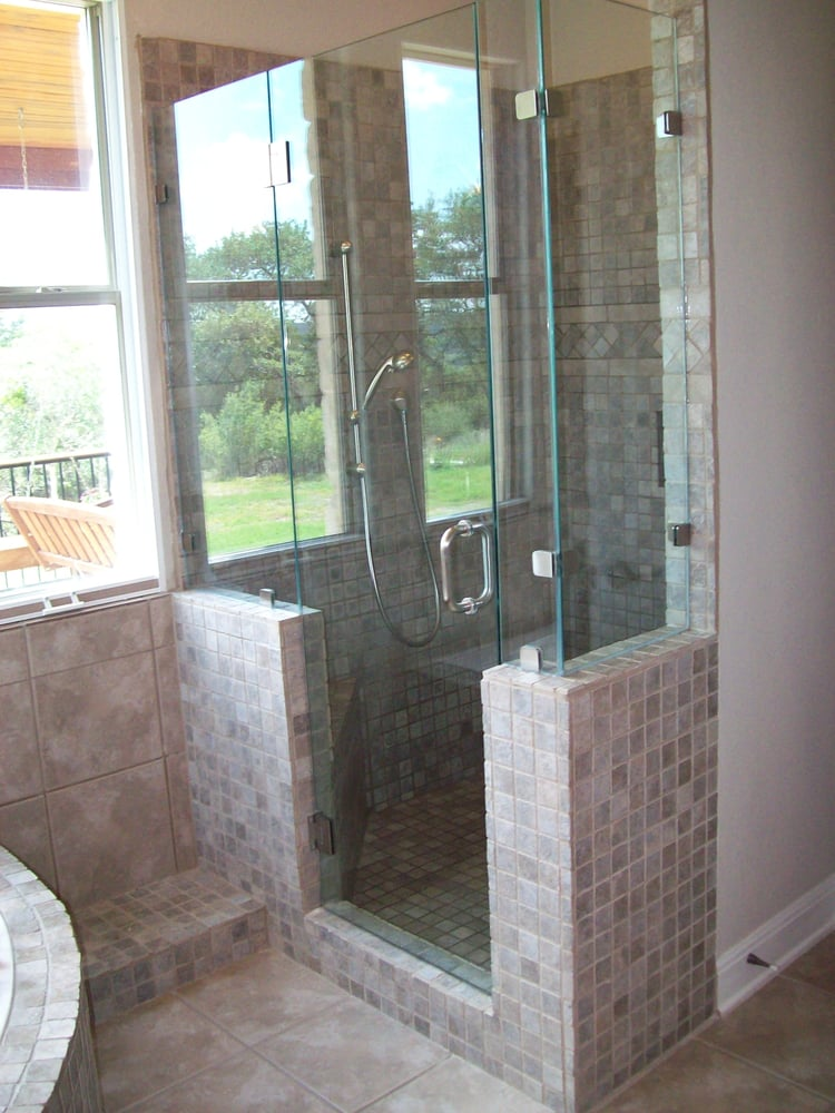 custom built walk in shower with seamless glass and multi shower ...