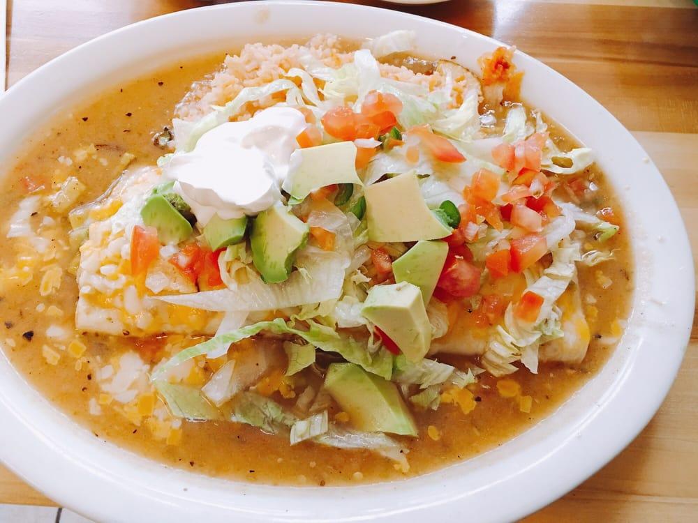 Taqueria La Familia - Denver, CO, United States. HUGE burrito with all kinds of yummy goodness on top.